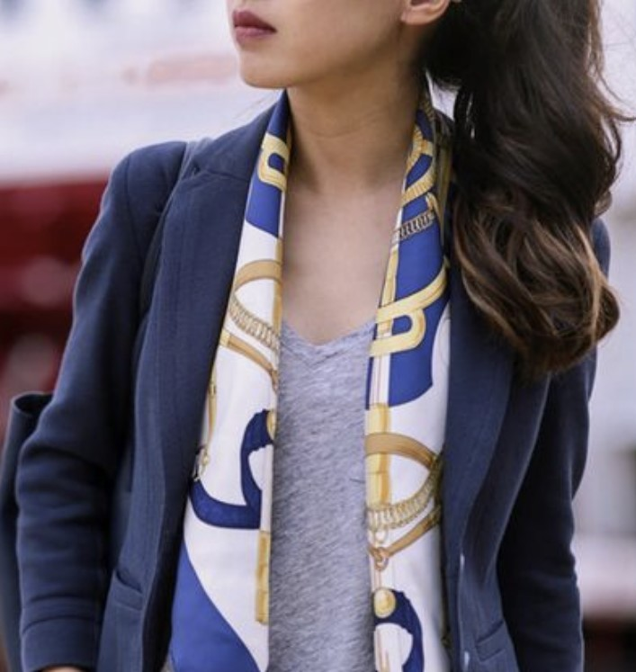 Adding a scarf to an outfit